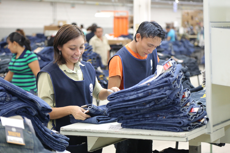 VF associates at a garment manufacturing facility in Mexico, do a final inspection of products before they are prepared for packing and shipping.